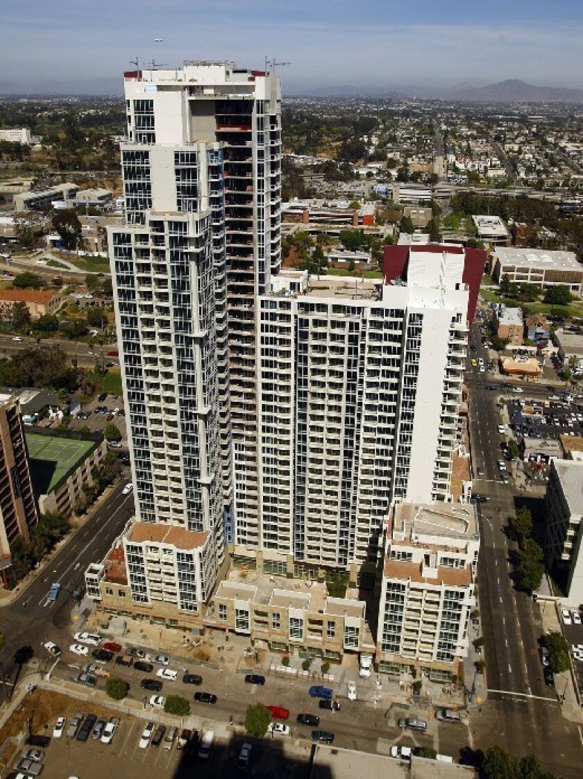 Vantage Pointe, a nearly finished 700-unit condo high-rise near San Diego City College, has contracts with about 300 buyers. (K.C. Alfred / Union-Tribune)