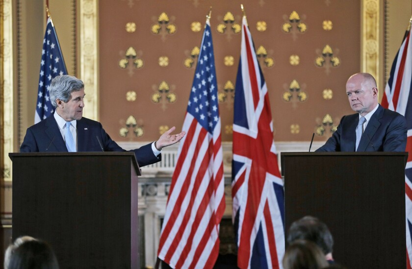 Secretary of State John Kerry, left, and British Foreign Secretary William Hague hold a joint news conference after a meeting Monday in London.