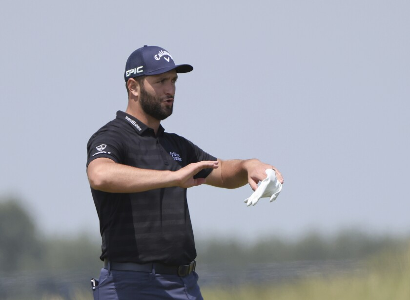 Spain's Jon Rahm gestures on the practice ground ahead of a practice round for the British Open Golf Championship at Royal St George's golf course Sandwich, England, Tuesday, July 13, 2021. The Open starts Thursday, July, 15. (AP Photo/Ian Walton)