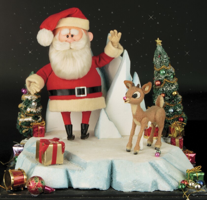 """This image released by Profiles in History shows a Santa Clause and Rudolph reindeer puppet used in the filming of the 1964 Christmas special """"Rudolph the Red-Nosed Reindeer."""" The soaring reindeer and Santa Claus figures who starred in in the perennially beloved stop-motion animation Christmas special """"Rudolph the Red Nosed Reindeer"""" are going up for auction.Auction house Profiles in History announced Thursday that a 6-inch-tall Rudolph and 11-inch-tall Santa used to animate the 1964 TV special are being sold together in the auction that starts Nov. 13 and are expected to fetch between $150,000 and $250,000. (Profiles in History via AP)"""