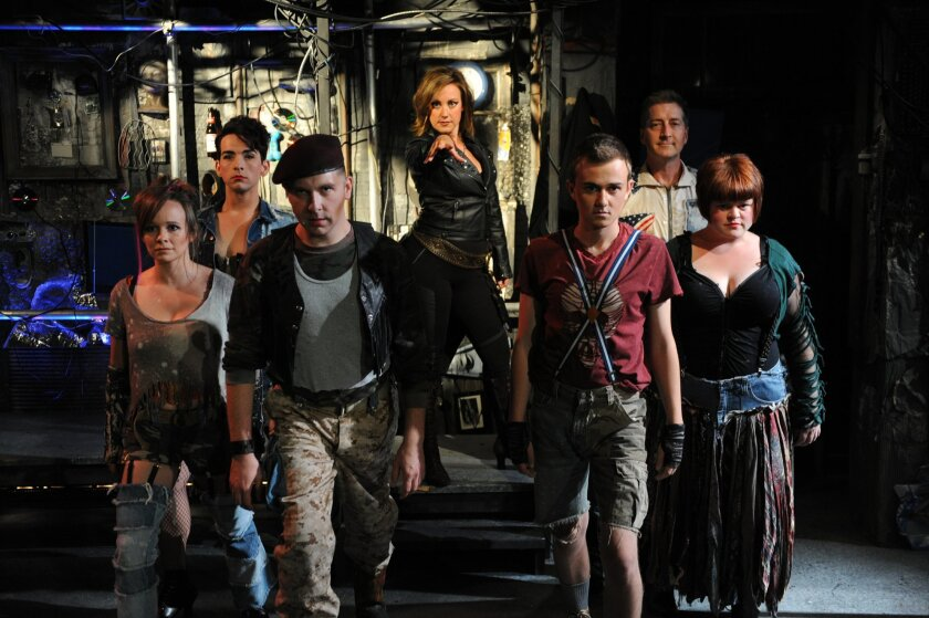 "Courtney Corey (center) leads the cast of Diversionary Theatre's ""Pippin."""