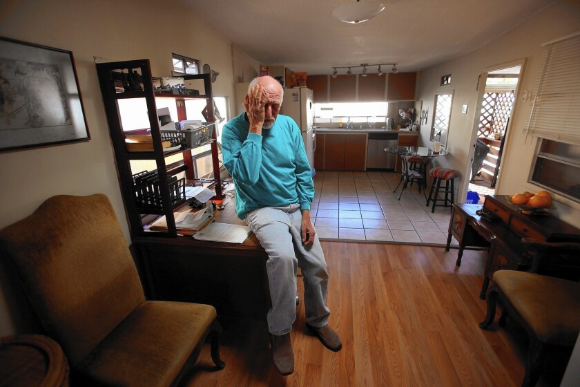 Israel Shachar, 64, in his double-wide mobile home in Culver City. His home is worth much more to him than the $24,050 being offered by a developer.