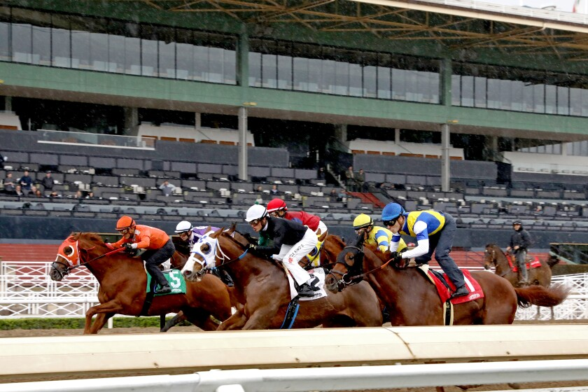 A race takes place at Santa Anita Park on March 14, 2020.