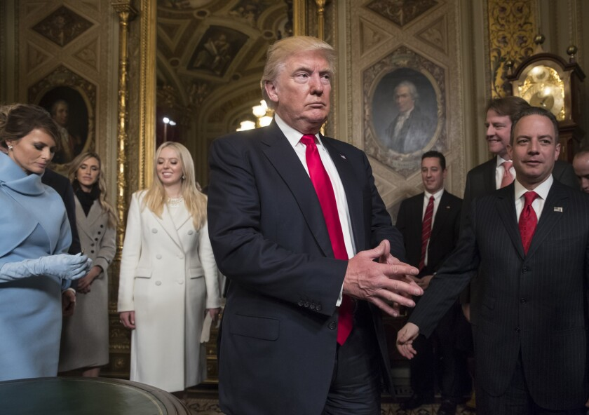 President Donald Trump leaves the Senate's President's Room at the U.S. Capitol after he formally signed his cabinet nominations on Inauguration Day, Jan. 20, 2017. White House counsel Donald McGahn stands second from right, behind then-chief of staff Reince Priebus.