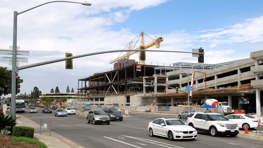 Vehicles pass by the UTC Transit Center Station on Genesee Avenue, next to the Westfield UTC shopping mall, when it was under construction three years ago.