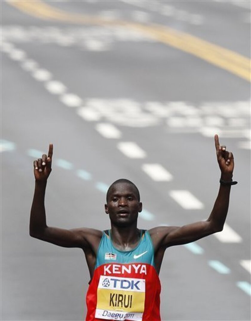 Kenya's Abel Kirui crosses the finish line to win gold during the Men's Marathon at the World Athletics Championships in Daegu, South Korea, Sunday, Sept. 4, 2011. (AP Photo/Anja Niedringhaus)