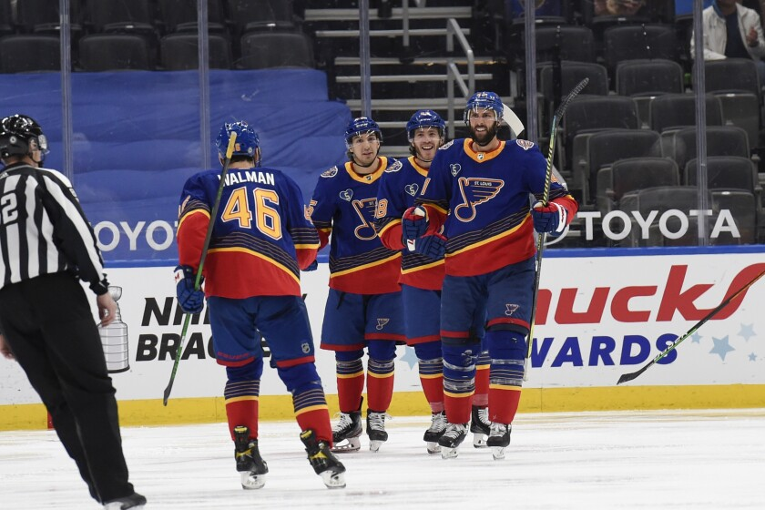 St. Louis Blues' Robert Bortuzzo (41) is congratulated by teammates after scoring a goal against the Anaheim Ducks during the third period of an NHL hockey game on Monday, May 3, 2021, in St. Louis. (AP Photo/Joe Puetz)