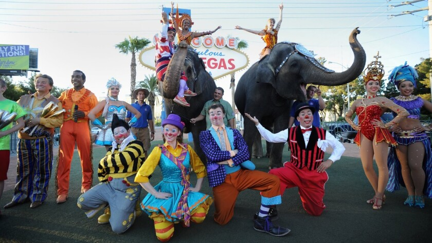 In this photo provided by the Las Vegas News Bureau, two elephants and performers from Ringling Bros