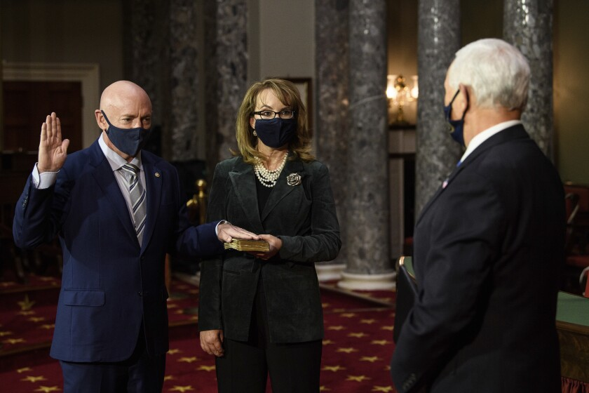 Sen. Mark Kelly in a reenactment of his swearing-in with wife Gabrielle Giffords and Vice President Mike Pence.