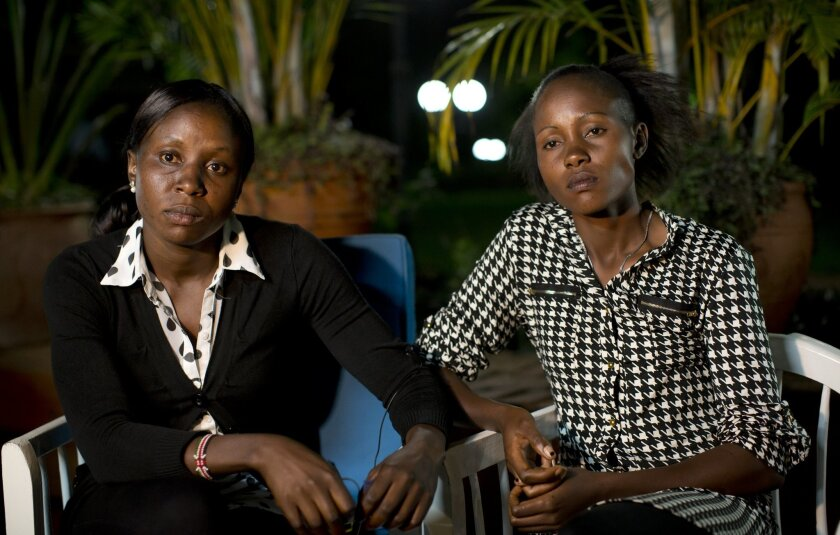 In this photo taken Thursday, Feb. 4, 2016, Joy Sakari, a 400-meter runner, left, and Francisca Koki Manunga, a hurdler, right, who were both banned for doping at the 2015 world championships, speak exclusively to The Associated Press in the town of Embu, Kenya. The two Kenyan athletes serving a fo