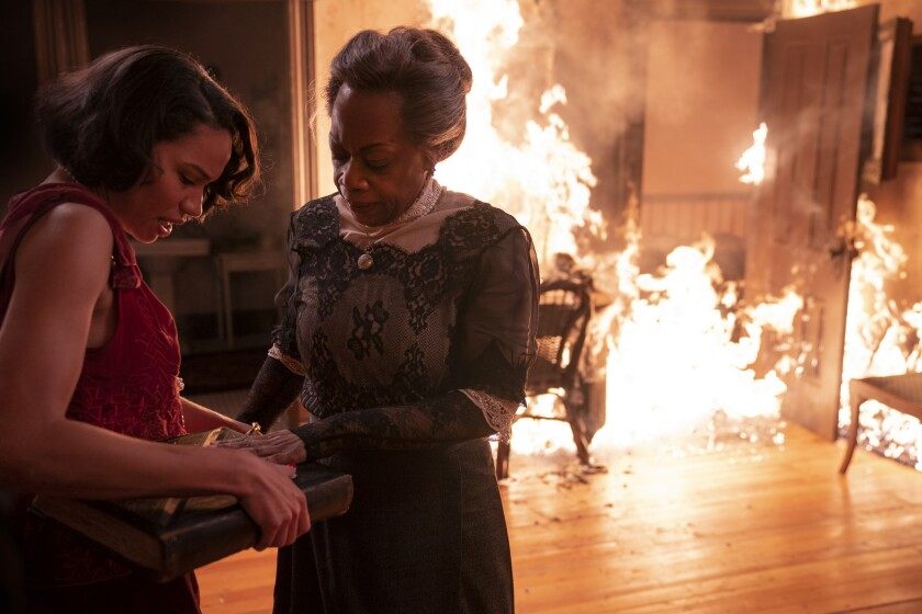 """Jurnee Smollett, left, and Regina Taylor in """"Lovecraft Country,"""" which travels back in time to the 1921 Tulsa Race Massacre."""