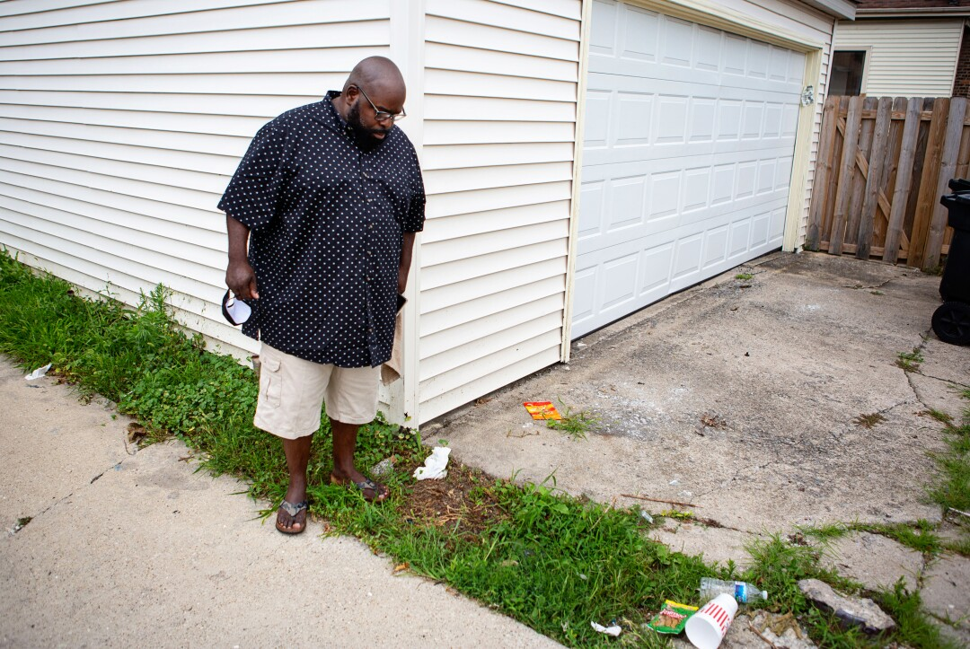 Donovan Price looks down at the spot where 9-year-old Tyshawn Lee was lured to an alley and killed.