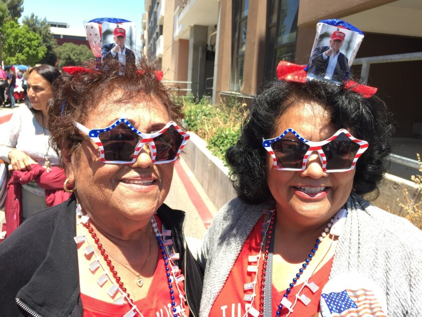 Elena Pineda, 81, and her daughter Mary Jennings, 57, attend a rally for Republican presumptive presidential nominee Donald Trump in Fresno on Friday. Some of Jennings' family have stopped speaking to her over her support for Trump.