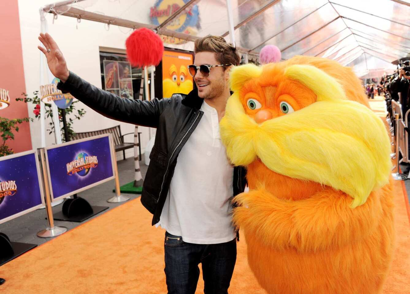 """Zac Efron and the cast of """"The Lorax"""" hit the red carpet at Universal City on Feb. 19 to celebrate the opening of the new Dr. Seuss children's movie. Efron provides the voice of Ted, a 12-year-old boy from the artificial town of Thneed-Ville who sets out in search of real trees to impress a girl."""