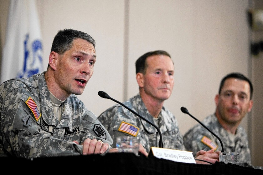 Col. Bradley Poppen, left, Maj. Gen. Joseph P. DiSalvo and Col. Ronald Wool discuss the condition of Sgt Bowe Bergdahl at a news conference at Ft. Sam Houston in San Antonio.