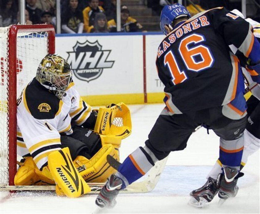 Boston Bruins goalie Marty Turco (1) makes a save on a shot by New York Islanders Marty Reasoner (16) during the second period of an NHL hockey game at the Nassau Coliseum in Uniondale, N.Y., Saturday, March 31, 2012. The Bruins won 6-3.P Photo/Paul J. Bereswill)