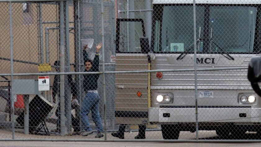 Suspected illegal immigrants are unloaded at the GEO/ICE detention Center.