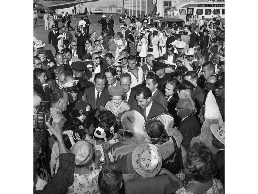 Aug. 2, 1960: Republican presidential nominee Richard Nixon and his wife, Pat, arrive at Los Angeles International Airport.