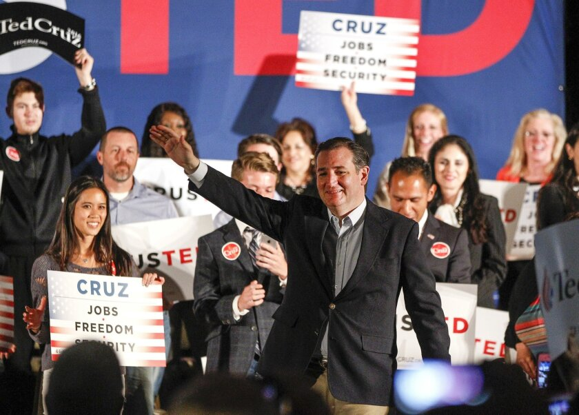 Republican presidential candidate Ted Cruz waves to the crowd after taking the stage.