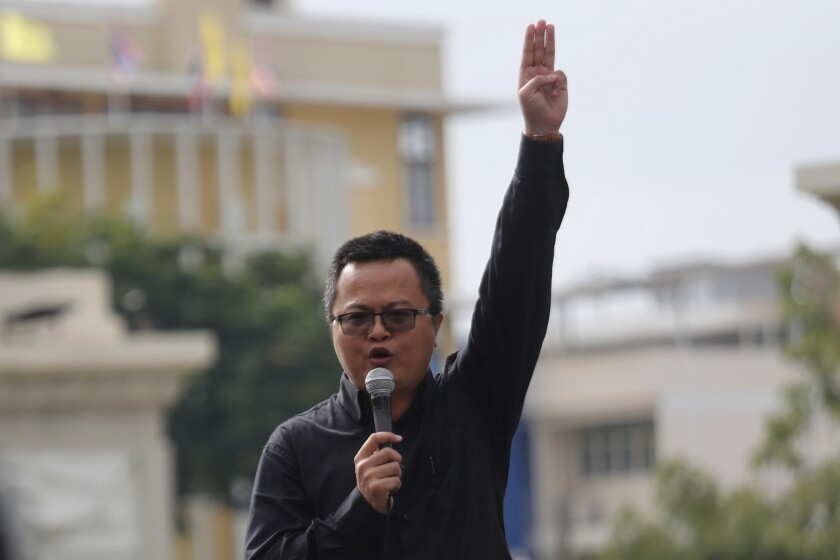 Human rights lawyer Arnon Nampha raises a three-finger salute, a symbol of resistance, talks to supporters during a protest near Democracy monument Bangkok, Thailand, Wednesday, Oct. 14, 2020. Thai political activists hope to keep up the momentum for their campaign for democratic change with their third major rally in the capital Bangkok on Wednesday. (AP Photo/Sakchai Lalit)