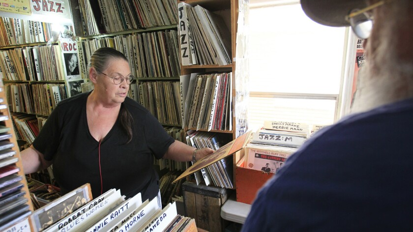 Virginia and Lou Curtiss in their semi-legendary store, Folk Arts Rare Records in North Park. The store is closing at the end of June. Lou has been a mentor to many San Diego performers including Mojo Nixon, Tom Waits, A.J. Croce, Gregory Page.
