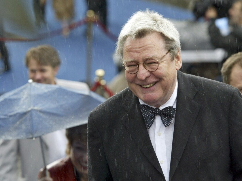 "FILE - Film director Alan Parker arrives at the opening ceremony of 26th Moscow International Film Festival in Moscow on June 18, 2004. Parker, whose movies included ""Bugsy Malone,"" ""Midnight Express"" and ""Evita,"" has died at the age of 76. A statement from the director's family says Parker died Friday in London after a long illness. (AP Photo/Misha Japaridze, File)"