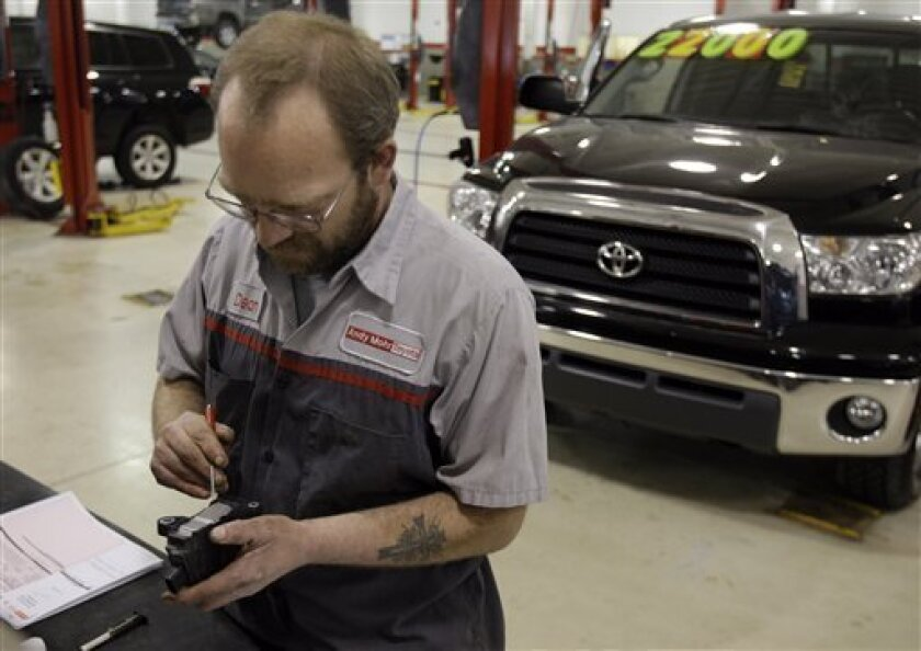 Service technicians Dean Baker repairs a gas pedal assembly at Andy Mohr Toyota in Avon, Ind., Wednesday, Feb. 3, 2010. Toyota Motor Corp. has issued the parts to fix sticky gas pedals to repair the vehicles of the 4.2 million customers affected by the recall. (AP Photo/Michael Conroy)