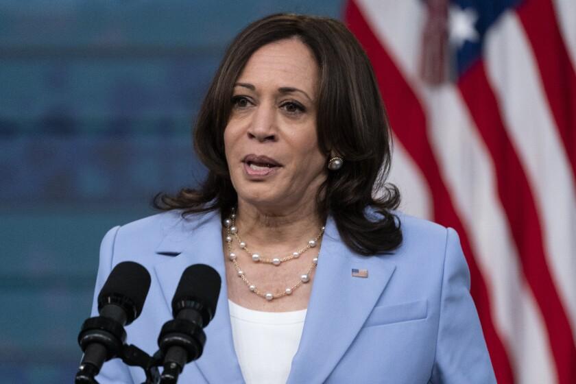 Vice President Kamala Harris at a microphone