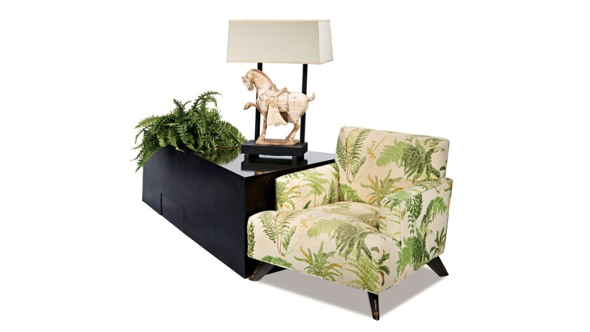 A Tang-style horse lamp, estimated at $7,000 to $9,000, is bolted on a triangular side table with planter ($1,500-$2,000). Next to it, a Seniah (Haines' name spelled backward) chair, valued at $3,000 to $5,000.