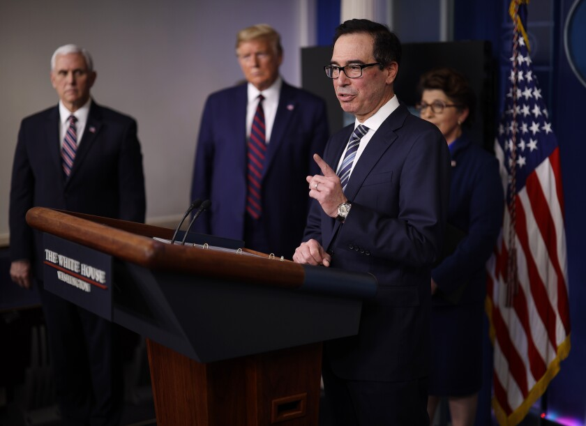 Treasury Secretary Steven T. Mnuchin speaks in the press briefing room with President Donald Trump.