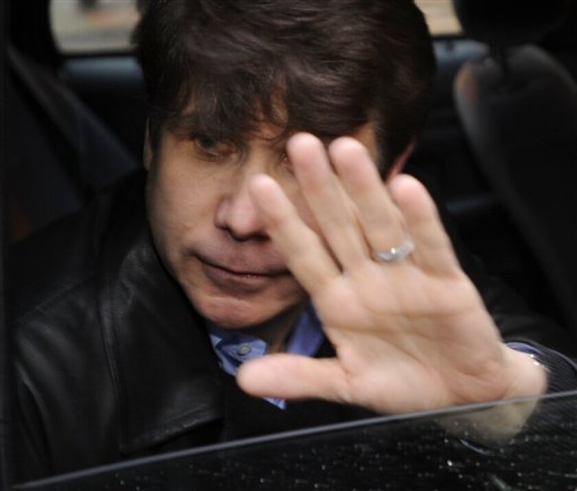 Illinois Gov. Rod Blagojevich leaves a downtown building where a high profile defense attorney has an office Saturday, Dec. 13, 2008, in Chicago. Blagojevich was arrested this week on federal charges that he tried to sell President-elect Barack Obama's vacant Senate seat. (AP Photo/Paul Beaty)