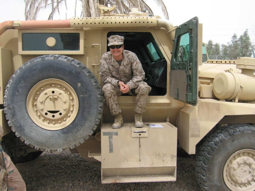 Susie Alderson with an early version of the MRAP anti-mine vehicle in Iraq.