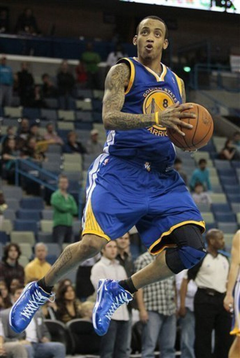 Golden State Warriors guard Monta Ellis goes up for a basket against the New Orleans Hornets in the second half of an NBA basketball game in New Orleans, Wednesday, Jan. 5, 2011. Ellis contributed a game-high 29 points to Golden State's 110-103 win over New Orleans. (AP Photo/Patrick Semansky)