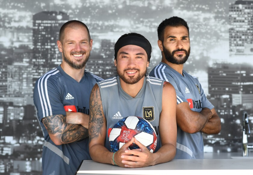 From left, LAFC players Jordan Harvey, Lee Nguyen and Steven Beitashour sport beards until they win their first playoff game.