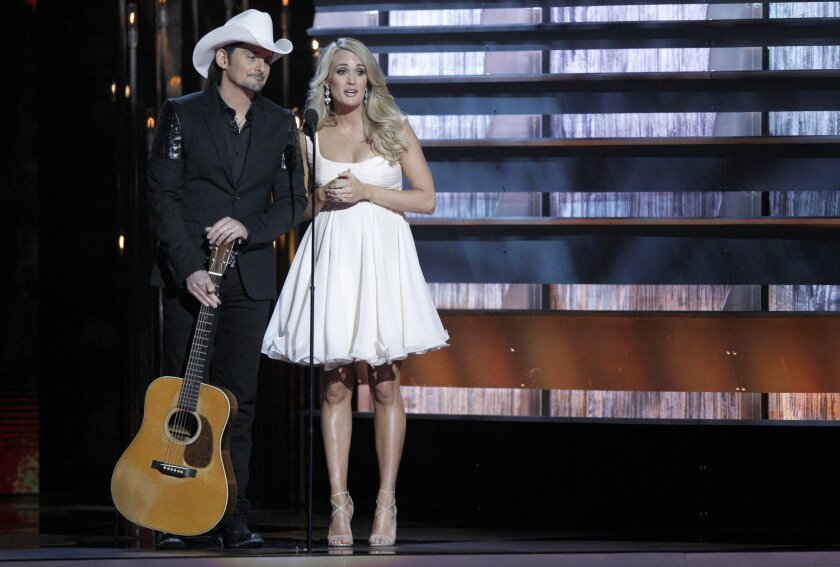 FILE - In this Nov. 5, 2014 file photo, hosts Brad Paisley, left, and Carrie Underwood appear at the 48th annual CMA Awards in Nashville, Tenn. The pair return to host another CMA Awards event, Wednesday, Nov. 4, 2015, which includes three days of rehearsals.  (Photo by Wade Payne/Invision/AP, File