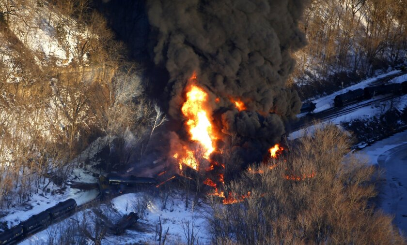 Smoke and flames erupt from the scene of a train derailment March 5, 2015, near Galena, Ill. A BNSF Railway freight train loaded with crude oil derailed in a rural area where the Galena River meets the Mississippi.