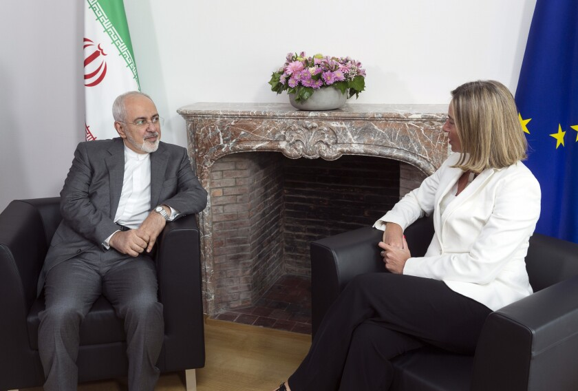 European Union foreign policy chief Federica Mogherini, right, meets with Iranian Foreign Minister Javad Zarif prior to a meeting of the E-3 and Iran at the Europa building in Brussels on Tuesday, May 15, 2018.