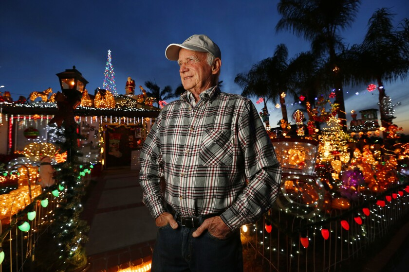 Bill Gilfillen stands amid Christmas lights in his front yard