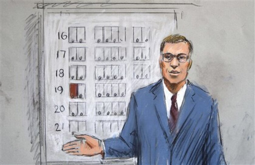 In this courtroom drawing, Assistant U.S. Attorney Jonathan Tukel shows an airline seating chart in U.S. District Court, Tuesday, Oct. 11, 2011, in Detroit. Opening arguments in the trial of Umar Farouk Abdulmutallab, the Nigerian man accused of trying to bring down a jetliner with a bomb in his underwear, got under way Tuesday. (AP Photo/Jerry Lemenu)