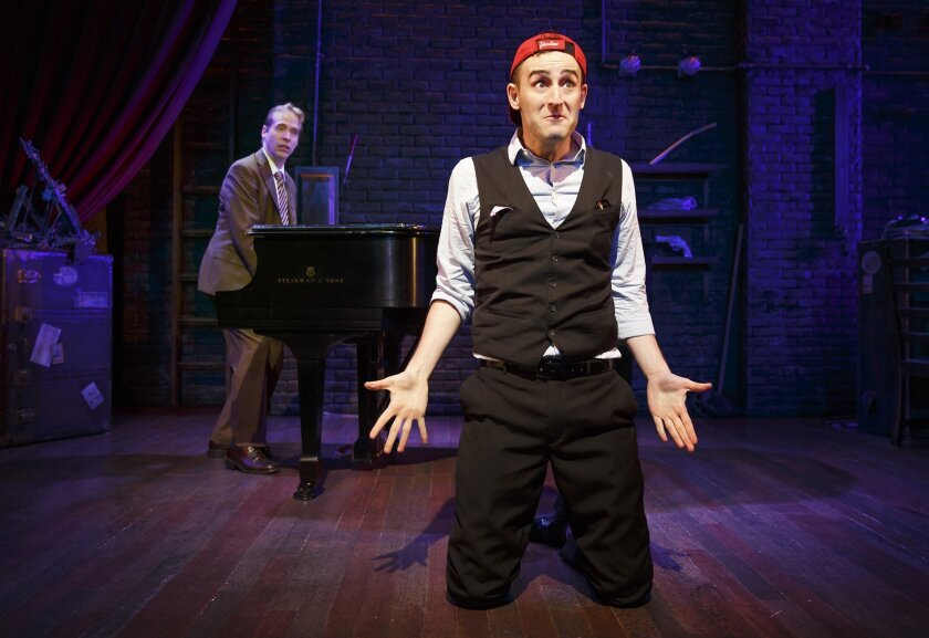 Marcus (Ian Lowe) at the piano and The Suspects (Joe Kinosian) keep crazily busy in 'Murder for Two,' with book and music by Kinosian, book and lyrics by Kellen Blair, and direction by Scott Schwartz.