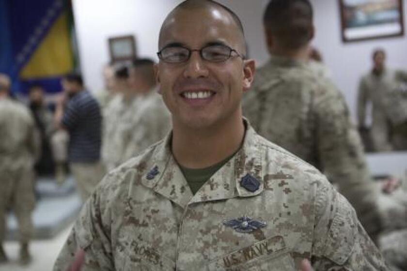 """Navy corpsman Benny Flores displayed """"extraordinary guidance, zealous initiative, and total dedication to duty"""" during a Taliban ambush, his Silver Star citation said."""