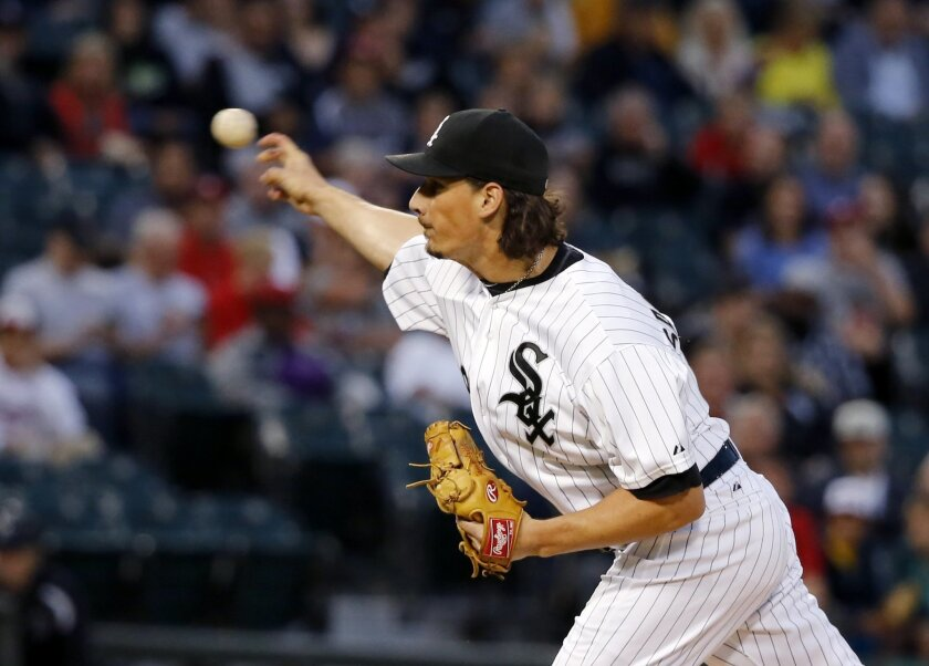 Chicago White Sox starting pitcher Jeff Samardzija delivers during the first inning of a baseball game against the Boston Red Sox Monday, Aug. 24, 2015, in Chicago. (AP Photo/Charles Rex Arbogast)