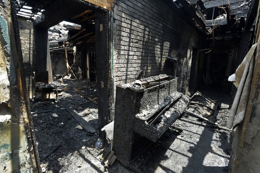 The charred remains of the back left wing of Briar Creek Road Baptist Church in Charlotte, N.C., on June 24.