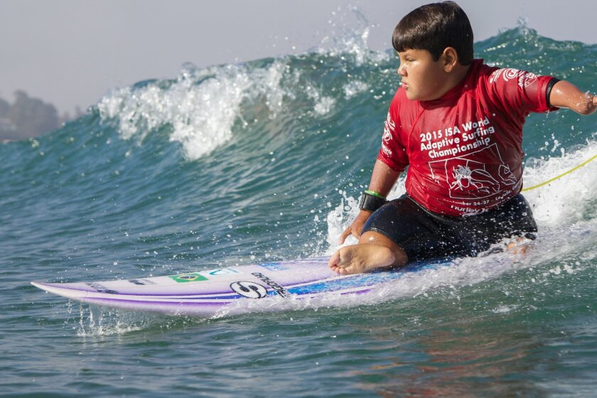 A young disabled boy participating in an adaptive surfing lesson hosted by the Challenged Athletes Foundation.
