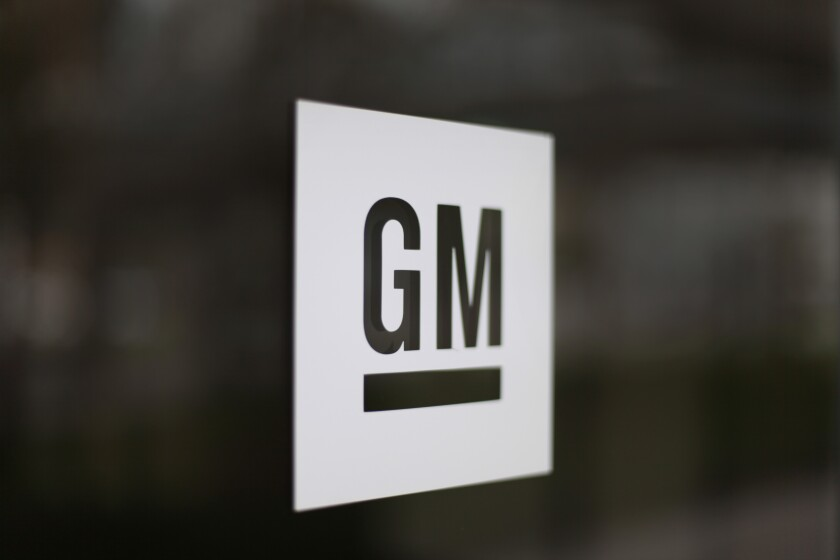 file photo of the General Motors logo at the company's world headquarters in Detroit.