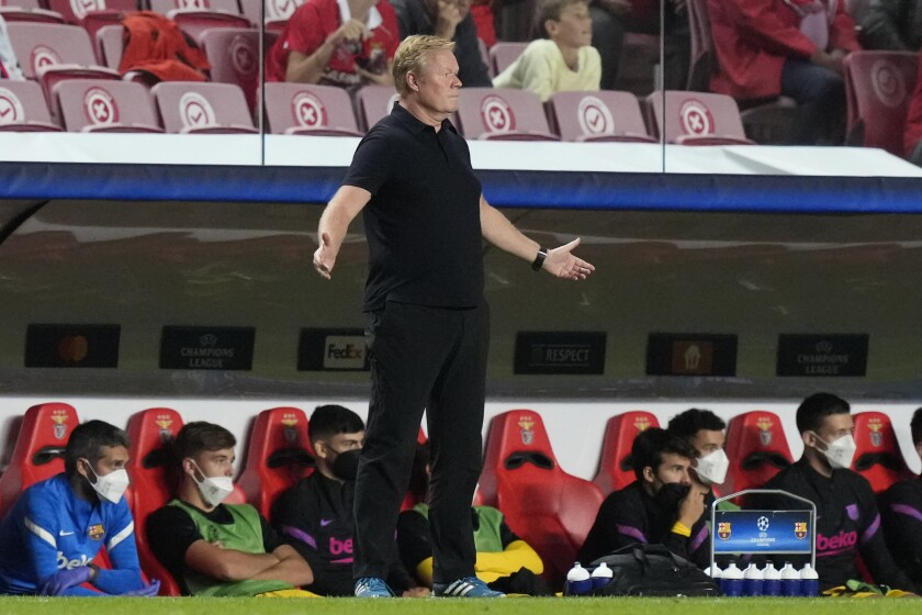 Barcelona's head coach Ronald Koeman reacts during a Group E Champions League soccer match between Benfica and Barcelona at the Luz stadium in Lisbon, Portugal, Wednesday, Sept. 29, 2021. (AP Photo/Armando Franca)