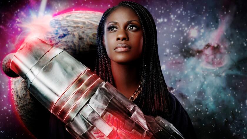 Nerdcore rapper Sammus with her arm cannon.