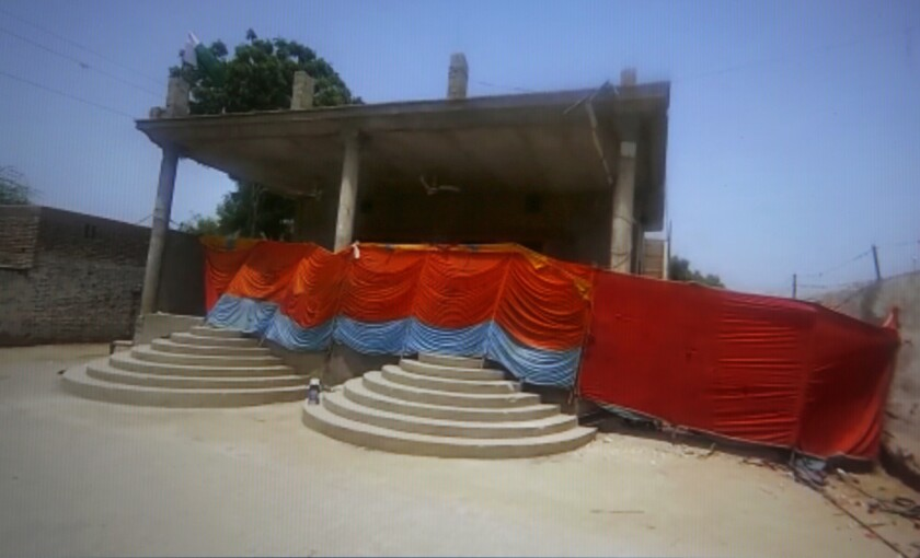 This frame grab image from video, shows a Hindu temple cordoned off by local authorities after it was stormed by a Muslim mob, in Bhong, in Rahim Yar Khan district, Pakistan, Thursday, Aug. 5, 2021. Pakistan on Thursday deployed paramilitary troops in a conservative town in the country's eastern Punjab province to avoid any communal violence after a Muslim mob badly damaged a Hindu temple there. Wednesday's attack happened after a court granted bail to an eight-year-old Hindu boy who allegedly desecrated a madrassa, or religious school, earlier this week. (AP Photo)