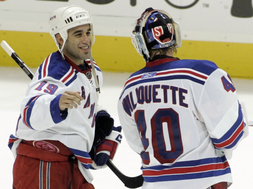 FILE - In this Wednesday, Dec. 10, 2008, file photo, New York Rangers' Scott Gomez (19) celebrates with goalie Steve Valiquette (40) after they beat the Atlanta Thrashers 3-2 in overtime in an NHL hockey game in Atlanta. Gomez scored the game-winning goal. Gomez was one of the first Latinos to reach the NHL in 1999 — Bill Guerin was the first — and he played 16 season for seven teams, winning the Stanley Cup twice with New Jersey. (AP Photo/John Amis, File)