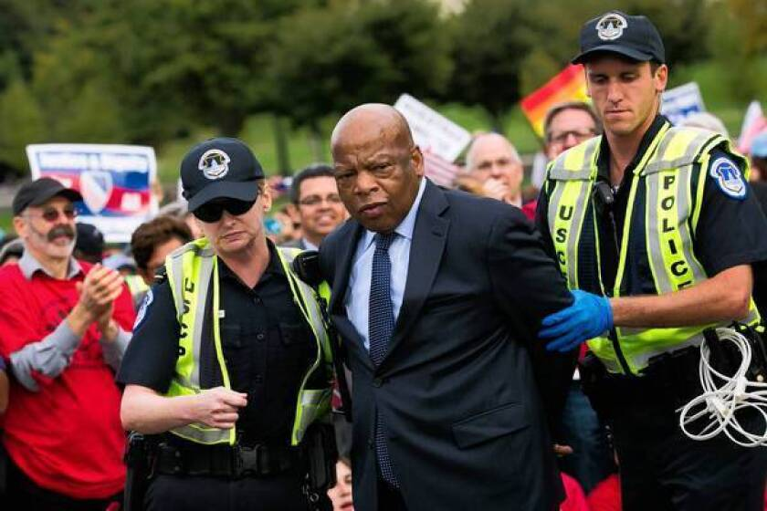 U.S. Rep. John Lewis (D-Ga.) is arrested outside the Capitol in Washington during a demonstration calling for the House to take up immigration overhaul legislation.